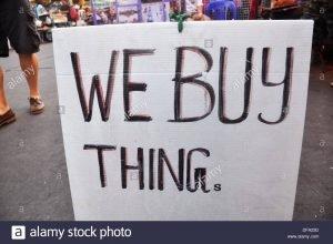 bangkok-thailand-funny-sign-we-buy-things-at-a-stall-in-khao-san-road-dfa23d